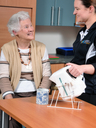 therapist demonstrating kettle tipper to client